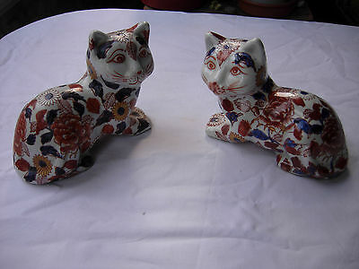 Chinese or Japanese porcelain cats, imari colours, 4 characters on base