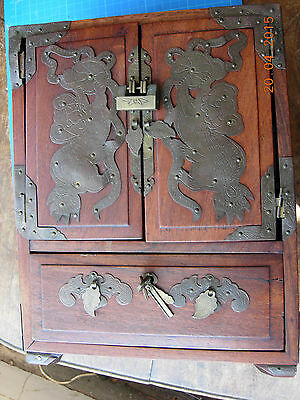 Chinese wooden box, nice lock, sadly warped out of shape, with brass fittings,