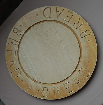 Vintage bread round board with BREAD carved around the edge.