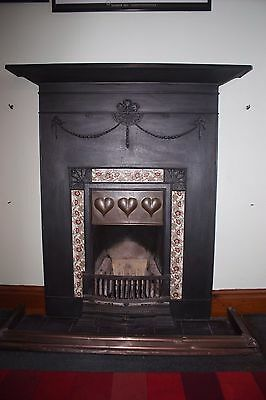 Vosey style cast iron fireplace