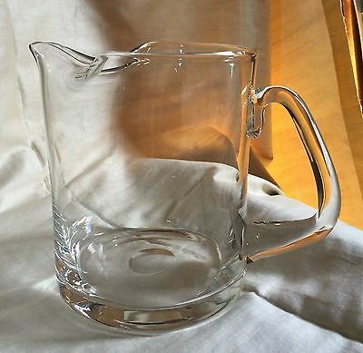 Hand blown pinched spout clear glass pitcher.Polished pontil, triangular handle.