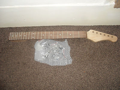 Strat style Guitar neck. +Machine heads.