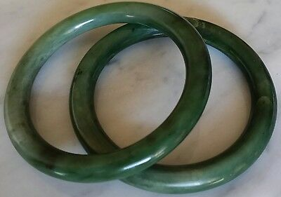 TWO CHINESE JADE BANGLE BRACELETS 1970s PURCHASE, RICH GREEN
