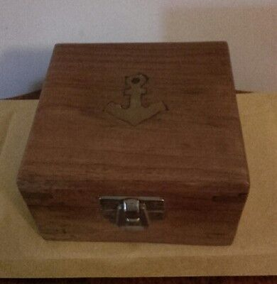 """4""""/10 cm hinged wooden (compass?) box with brass anchor & corner bindings."""
