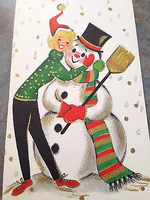 Vtg NOS Card Christmas Girl Lady Hugging Snowman Gold Falling Snow 50's Hallmark