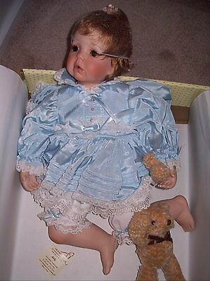 Doll/ Donna RuBert  She's porcelain and her name is Holly. Very life like.