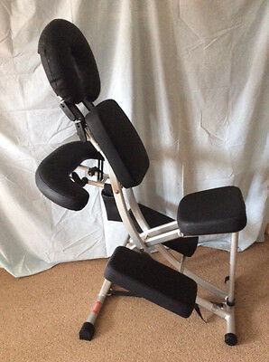 Massage Chair Ergonomic Folding - Black with carry case and shoulder strap.