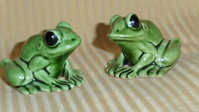 Two Frog figurines