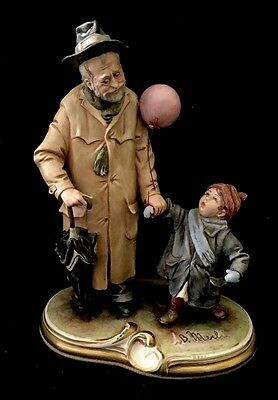 B. Merli Figurine Grandfather and Grandchild and a Pink Balloon - Large