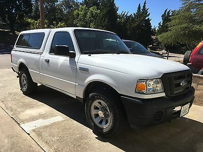 2011 Ford Ranger  pickup truck with camper shell