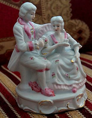Pink and white lady and gentleman figurine