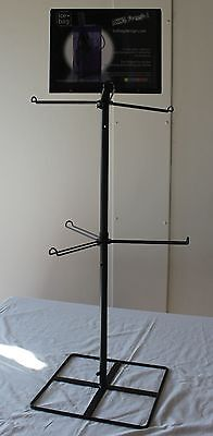 Retail display counter-top two tiered spinner / stand with mounted sign holder