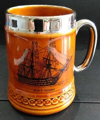 A Vintage Treacle Glazed Tankard Lord Nelson Ware With Hms Victory Illustration