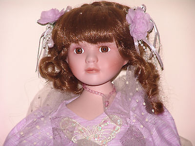 Beautiful Porcelain sitting doll Violet 11 inch