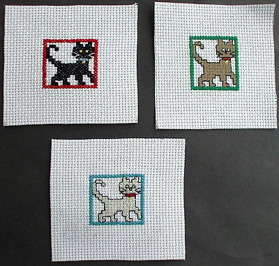 Completed Cross Stitch Cats  x 3
