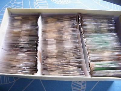 World off paper hoard in plastic packets. 1,000s of stamps. Ref-246