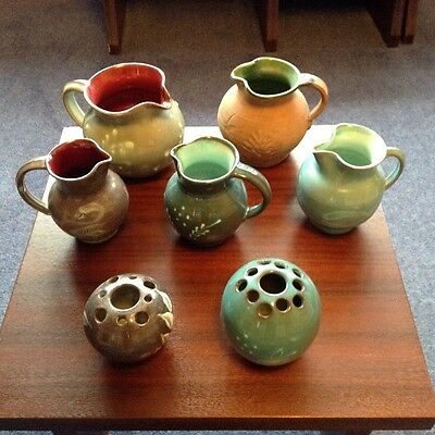 Selection of GH Dunster pottery jugs and pot pouri