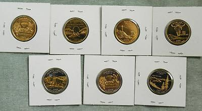 Assortment of 7 Gold & Two Tone State Quarters