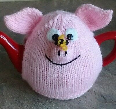 Hand-knitted Percy Pig+bee tea cosy