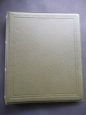 Green Stock Book/Stamp Album Contains World Stamps