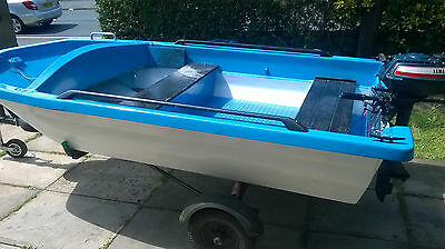 10 ft dory type boat with rebuilt trailer and outboard motor