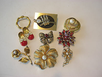 Small lot of 9 fashion brooches/pins, all gold tone with stones and faux pearls