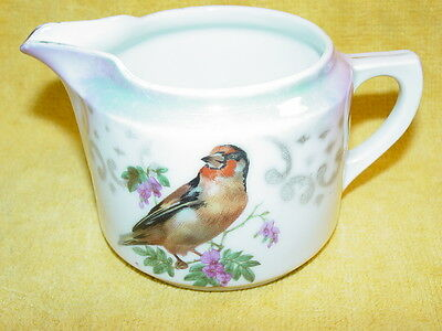 Antique creamer, Germany Porcelain with bird & flowers & Luster background