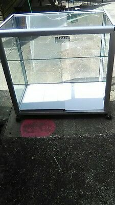 Very heavy glass and alloy shop display cabinet/counter with 2 inner shelves.