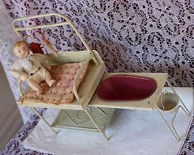 Antique all bisque bent leg baby doll with  Antique Tin Changing station RARE
