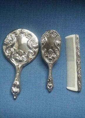 Mirror, brush and comb dressing table set