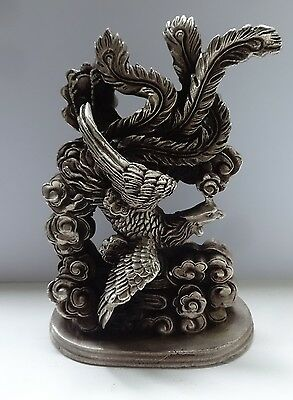 Solid cast metal silvered oriental exotic bird ornament