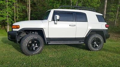 2014 Toyota FJ Cruiser  Near new condition, leveled, new tires and wheels.