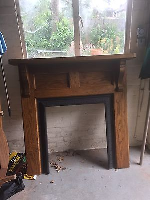 1930's solid wood fire surround and cast iron insert