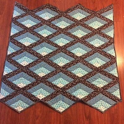Handmade turquoise and brown lap quilt