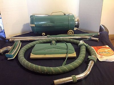 Vintage Electrolux Model L Canister Vacuum cleaner with accessories