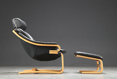 VINTAGE RETRO SWEDISH LEATHER CHAIR AND OTTOMAN 1970s