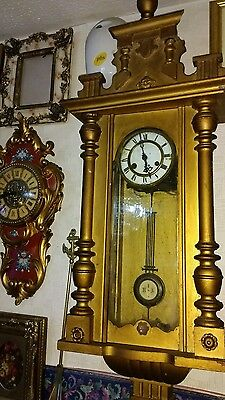 Antigue Vienna charming wall clock with pendulum in gold post 1900