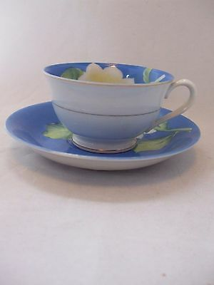 Lovely Royal Blue Porcelain Teacup/Saucer w/ White/Pink Flowers Made in Occupied