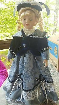 """16"""" Porcelain doll by Unique with stand"""