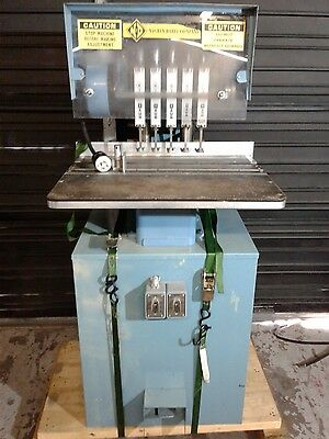 5 Hole Hydrolic  Baum  Paper Drill  Good Condition