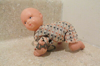 S38 vintage celluloid plastic wind up creeping baby doll toy
