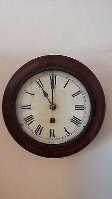 Petite antique French mahogony wall clock, 8 day mechanical movement circa 1830.