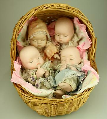 Lot of 4 Small Porcelain Dolls in Wicker Crib Unbranded SA10