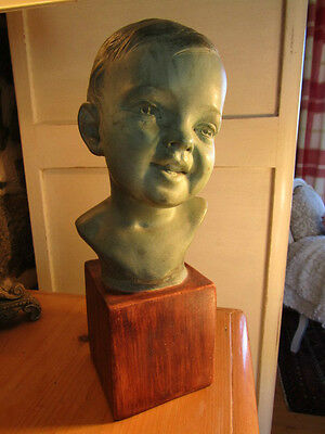 A Stunning Terracotta Art Deco Bust of an Infant/Child signed