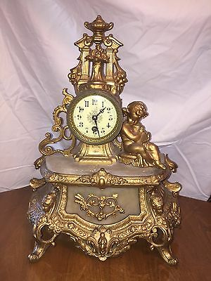 Antique French mantle clock with cherub. Marble & metal.