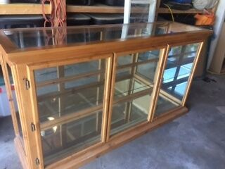 Oak and glass store display counter.