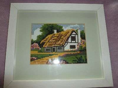 Framed small wool tapestry of a cottage