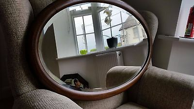 Edwardian inlaid mahogany oval mirror with bevelled glass