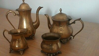 Metal tea set...: unab!e to determine metal..also tray not in picture