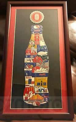 Framed 2000 Coca Cola Sydney Olympic Pins in Coke Bottle Shape Collection